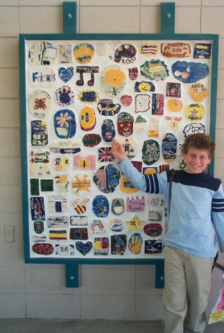 Jeffrey and his class plaque: Every year, all of the students in the 5th grade make tiles which are assembled into a plaque and hung on a wall on campus.